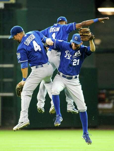 Alex Gordon (left), Jarrod Dyson and Jeff Francoeur celebrate the Royals' one-run win in Houston. Photo: AP