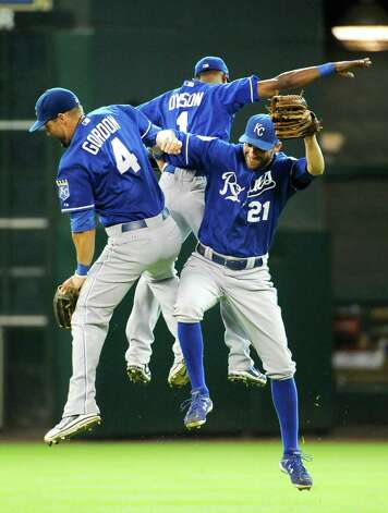 Kansas City Royals Alex Gordon (4), Jarrod Dyson (1) and Jeff Francoeur (21) celebrate their 2-1 win over the Houston Astros in a baseball game, Wednesday, June 20, 2012, in Houston. Photo: AP