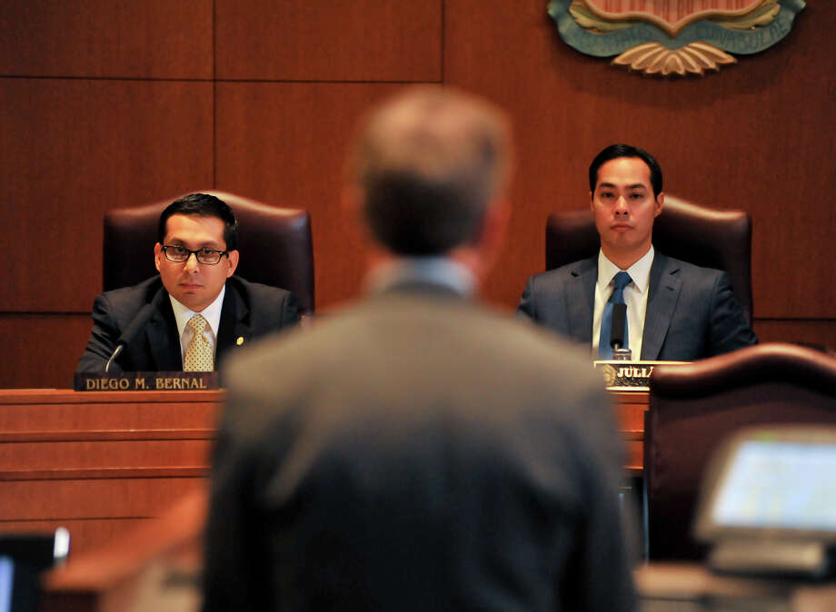 City council member Diego Bernal (left) and Mayor Julián Castro listen to a speaker during the Wal-Mart rezoning hearing on Feb. 16. 2012. Photo: Photo By Robin Jerstad/For The Express-News
