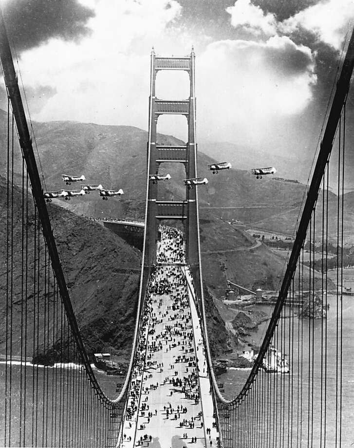 Opening day of the Golden Gate Bridge, 1937. Pedestrians walk on the bridge, while planes fly between the North and South Towers. Photo: Chronicle File Photo
