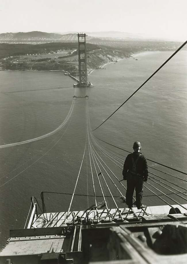 1936 - A bridge worker looks across to the San Francisco tower as cables are spun for the Golden Gate Bridge. Photo: Chronicle Archives