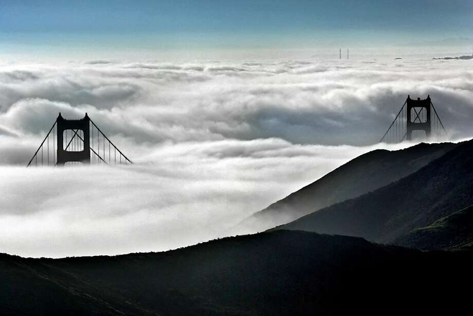 Fog engulfed the bay where only sites of the Golden Gate bridge can be seen at the highest points of Marin Headlands. Photo: Frederic Larson, The Chronicle
