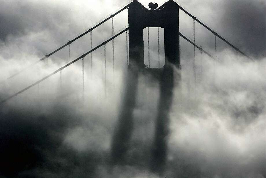 The south tower of the Golden Gate Bridge took on a reflection of it's own as the heavy fog reflected its own image. The dense fog causethe Bay Area morning commute to come to a crawl. 11/18/04 Photo: Frederic Larson, The Chronicle