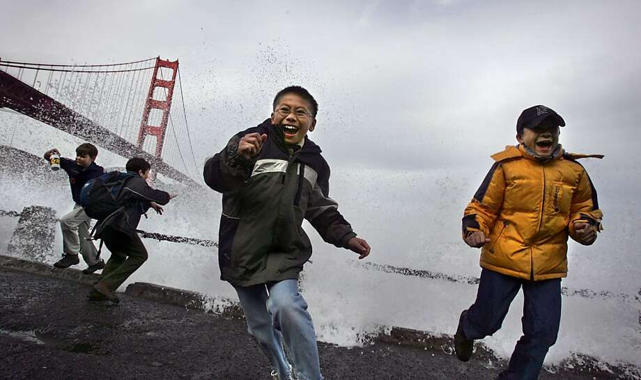 Ryan Young (10) center and his scout mate Jason Martin (10) (right) dodge the high surf at Fort Point under the Golden Gate Bridge during a Boy Scout hike with their troop from Santa Clara. All the boys in the hike found some enjoyment in playing in the high surf hitting the rocks off Fort Point from the recent weather. A brief let up rain forced many outside enjoying the calm before another storm blows in the Bay Area this week. Photo: Frederic Larson, The Chronicle