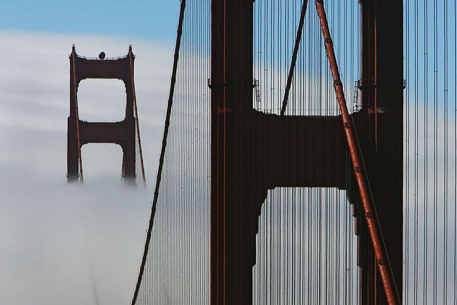 The Golden Gate Bridge south tower had a backdrop of white fog as seen from vista point north end. Photo: Frederic Larson, The Chronicle
