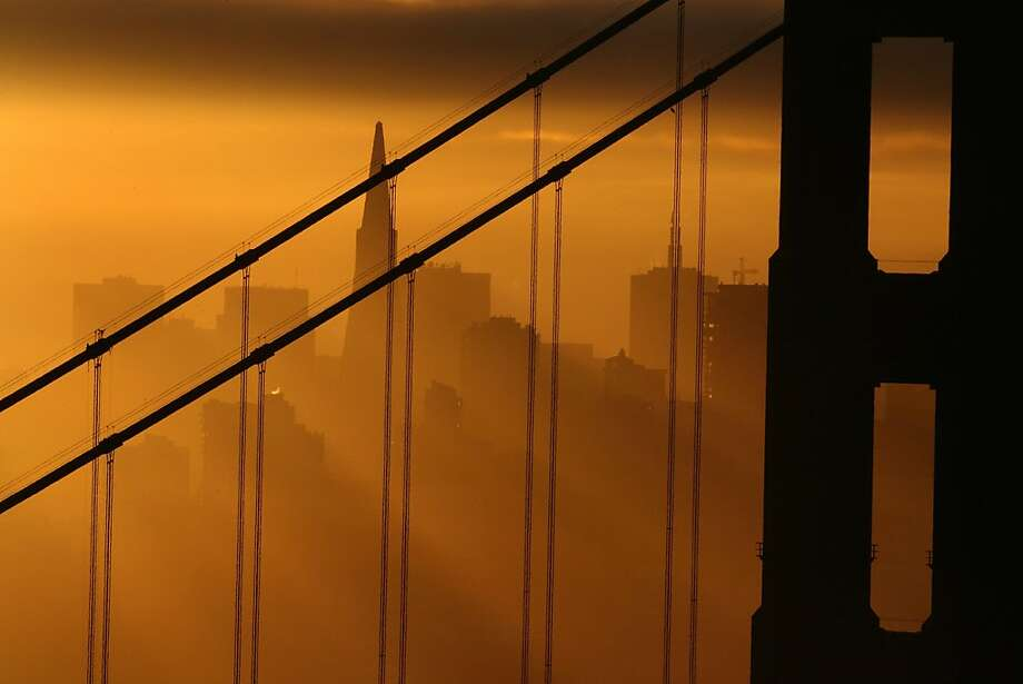 The sun rises over the Golden Gate Bridge seen from the Marin Headlands. Photo: Frederic Larson, SFC