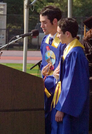 Masters of Ceremony Timothy Orlovsky, left, and Matthew Friedmann lead the saying of the Pledge of Allegiance during the graduation ceremony at Danbury High School on Wednesday, June 20, 2012. Photo: Jason Rearick / The News-Times