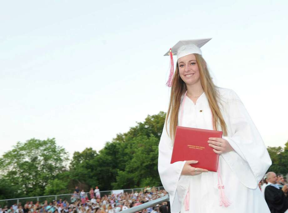 Lindsay Anibal, 18, after receiving her diploma during the Greenwich High School 2012 commencement at Cardinal Stadium Wednesday night, June 20, 2012. Photo: Bob Luckey / Greenwich Time