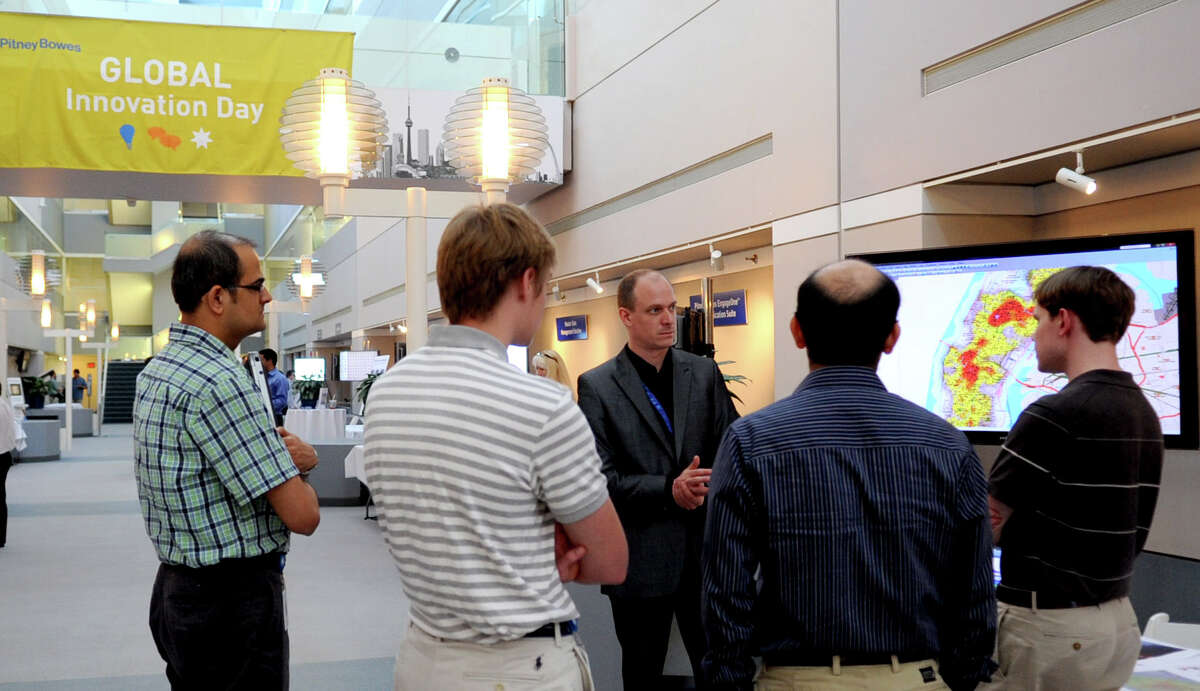 Chris Royles explains the program CrimeProfiler during Pitney Bowes' Tech Innovation Day at Pitney Bowes World Headquarters in Stamford on Wednesday, June 20, 2012.