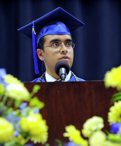 Valedictorian Ajit Singh speaks at the Newtown High School commencement exercises Wednesday, June 20, 2012, at the O'Neill Center in Danbury. Photo: Carol Kaliff / The News-Times