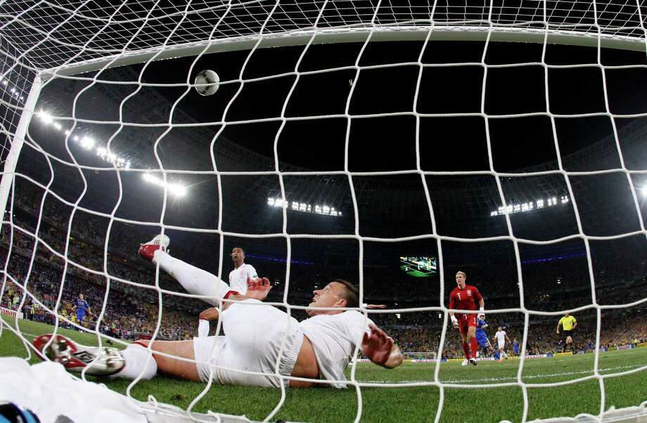 England's John Terry clears the ball away from his goal during the Euro 2012 soccer championship Group D match between England and Ukraine in Donetsk, Ukraine, Tuesday, June 19, 2012. (AP Photo/Matthias Schrader) Photo: Matthias Schrader