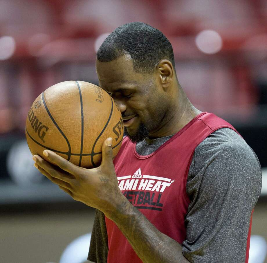 Miami Heat player LeBron James attends a practice on June 20, 2012 at the American Airlines Arena in Miami, Florida. The Heat and the Oklahoma City Thunder are preparing for Game 5 of their NBA Finals scheduled for June 21, 2012. AFP PHOTO/DON EMMERTDON EMMERT/AFP/GettyImages Photo: DON EMMERT