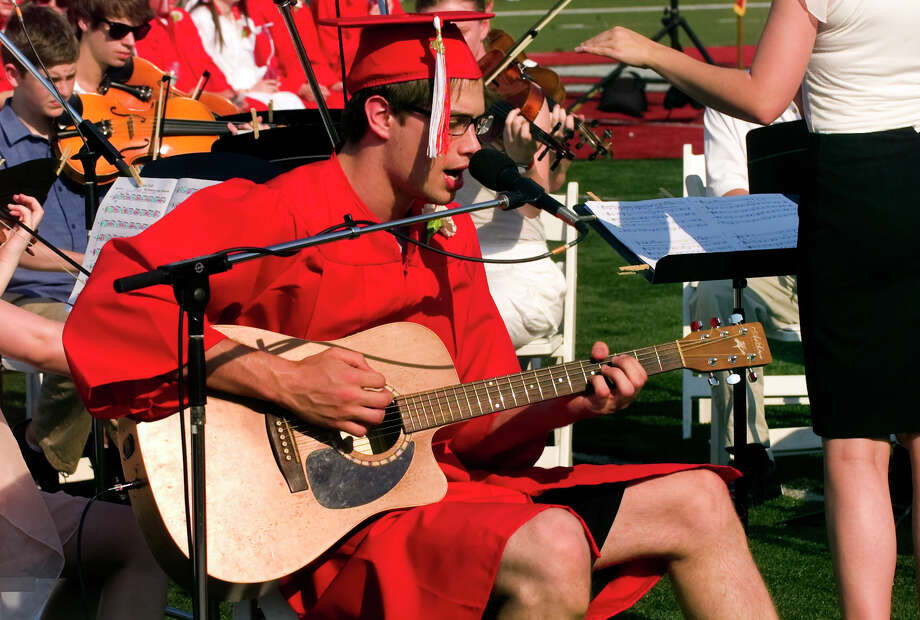 "Graduate Nick Depuy sings ""Falling Suns"" with the New Canaan High School String Ensemble, during the school's Class of 2012 Graduation Ceremony in New Canaan, Conn. on Wednesday June 20, 2012. Photo: Christian Abraham / Connecticut Post"