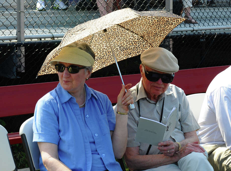 Frank and Rosemary Neuhaus, from Chicago, wait to see their grandchildren Robin and Jack Neuhaus graduate, during New Canaan High School's Class of 2012 Graduation Ceremony in New Canaan, Conn. on Wednesday June 20, 2012. Photo: Christian Abraham / Connecticut Post