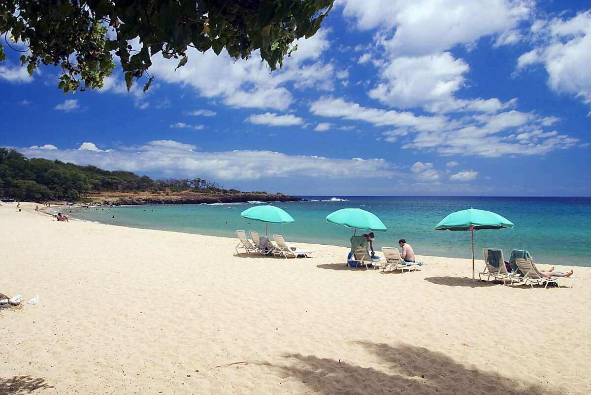Hulopoe Beach on Lanai in Hawaii. The beach is adjacent to the Four Seasons Manele Bay Resort. There's plenty of sand, shade trees and warm water for locals and tourists to share. (Gary A. Warner/Orange County Register/MCT)