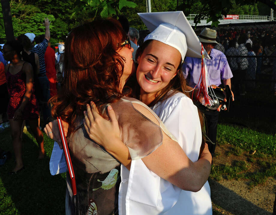 Graduate Olivia Bochicchio gets a hug from her mom Leigh, after New Canaan High School's Class of 2012 Graduation Ceremony in New Canaan, Conn. on Wednesday June 20, 2012. Photo: Christian Abraham / Connecticut Post