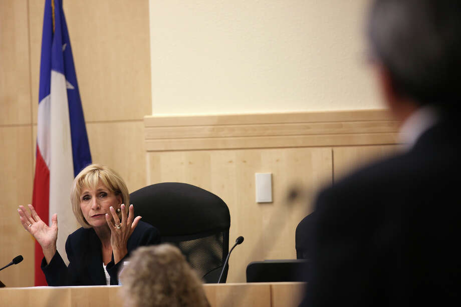 South San Antonio Independent School District Board member Connie Prado questions Business and Financial Services Executive Director David Landeros during their regular meeting, Wednesday, June 20, 2012. South San Antonio Independent School District Board member Connie Prado questions Business and Financial Services Executive Director David Landeros during their regular meeting, Wednesday, June 20, 2012. He was questioned after it was revealed that the district would have to reimburse the state to the tune $2.5 million. The money is from funds given to the district based on student attendance for the school year. Different factions on the board blamed the oversight on either Landeros or Interim Superintendent Linda Zeigler. Photo: Jerry Lara, San Antonio Express-News / ¨ 2012 San Antonio Express-News