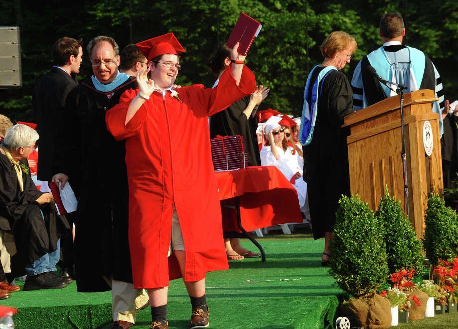 Graduate Ryan Rajkowski waves to his family after getting his degree, during New Canaan High School's Class of 2012 Graduation Ceremony in New Canaan, Conn. on Wednesday June 20, 2012. Photo: Christian Abraham / Connecticut Post