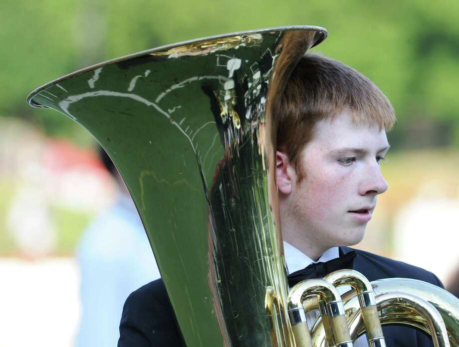 GHS student, Tarmo LeBlanc, 16, tuba player during the Greenwich High School 2012 commencement at Cardinal Stadium Wednesday night, June 20, 2012. Photo: Bob Luckey / Greenwich Time