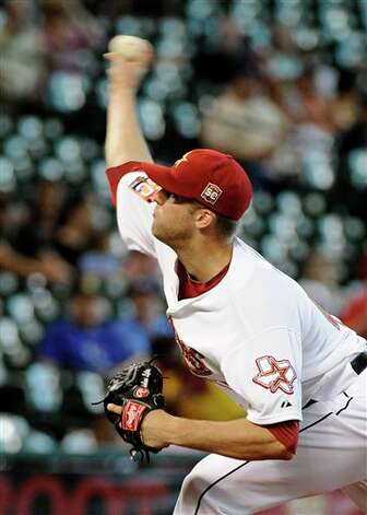 Houston Astros' Jordan Lyles delivers a pitch against the Kansas City Royals in the second inning of a baseball game Wednesday, June 20, 2012, in Houston. (AP Photo/Pat Sullivan) Photo: Associated Press