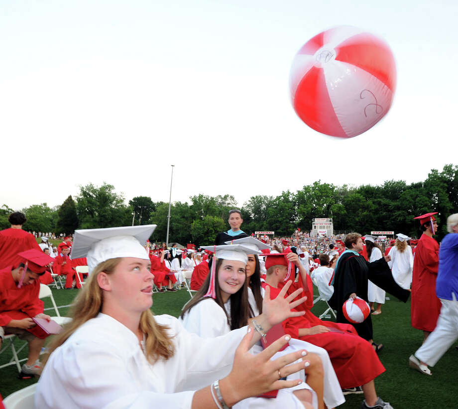 Shannon Colligan spins a beach ball during the Greenwich High School 2012 commencement at Cardinal Stadium Wednesday night, June 20, 2012. Photo: Bob Luckey / Greenwich Time