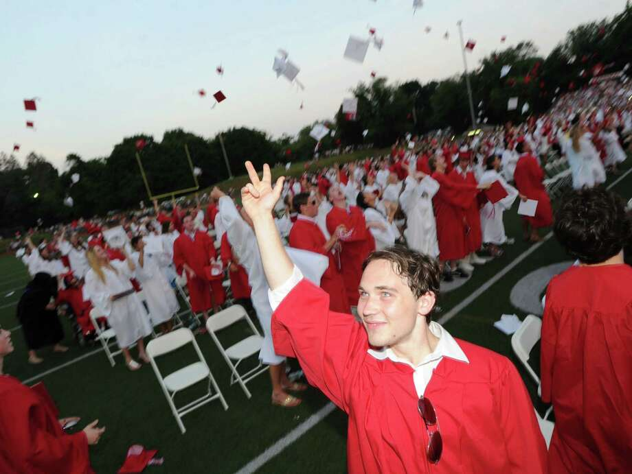 Sebastian Homewood throws his cap in the air during the Greenwich High School 2012 commencement at Cardinal Stadium Wednesday night, June 20, 2012. Photo: Bob Luckey / Greenwich Time