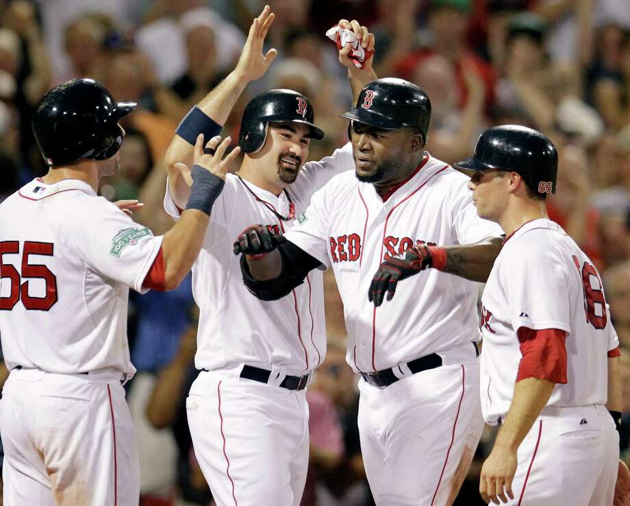 Boston Red Sox's David Ortiz celebrates his grand slam with Ryan Kalish (55), Adrian Gonzalez and Daniel Nava (66), who all scored during the fourth inning of an interleague baseball game against the Miami Marlins at Fenway Park in Boston on Wednesday, June 20, 2012. (AP Photo/Elise Amendola) Photo: Elise Amendola