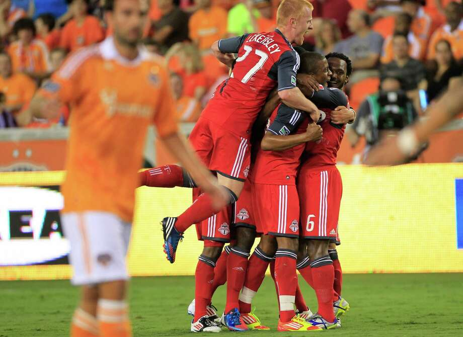 The Toronto FC celebrate after Danny Koevermans scored a goal during the first half of a soccer game against the Houston Dynamo at BBVA Compass Stadium Wednesday, June 20, 2012, in Houston. Photo: Cody Duty, Houston Chronicle / © 2011 Houston Chronicle