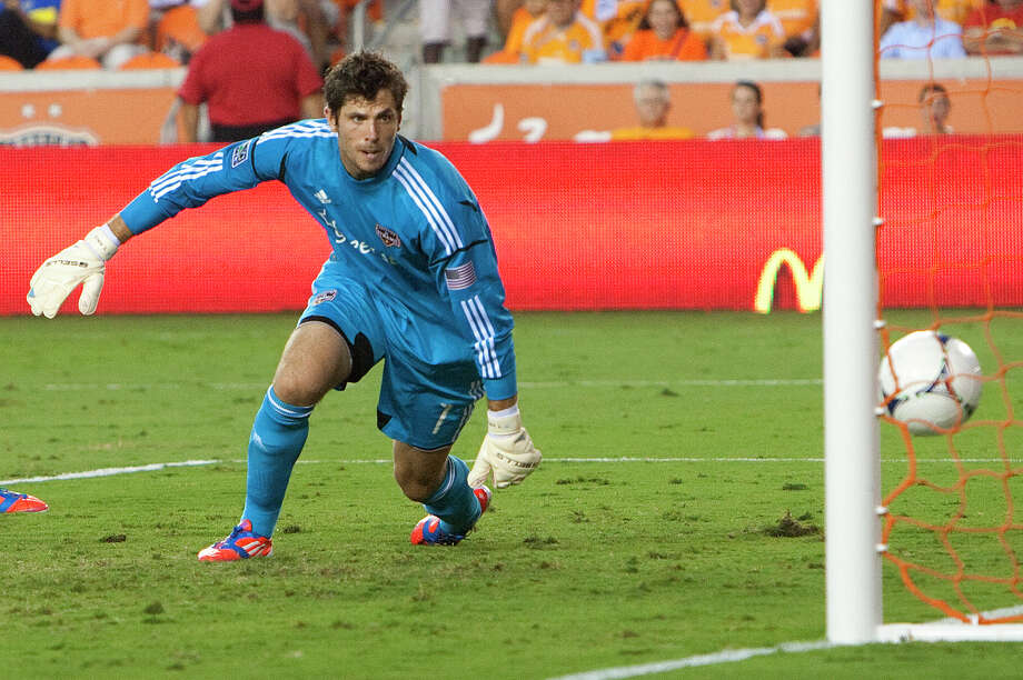 Houston Dynamo goal keeper Tally Hall misses a shot from Toronto FC's Danny Koevermans during the first half of a soccer game against the Houston Dynamo at BBVA Compass Stadium Wednesday, June 20, 2012, in Houston. Photo: Cody Duty, Houston Chronicle / © 2011 Houston Chronicle