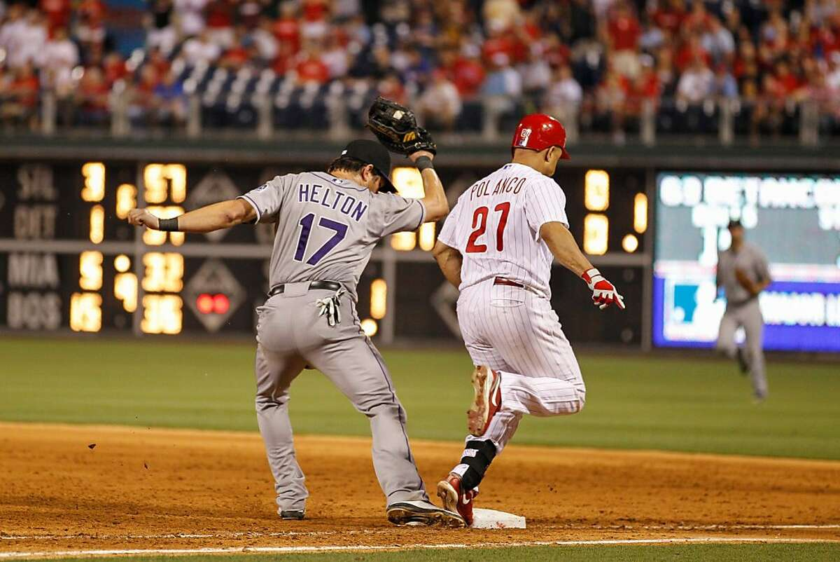 PHILADELPHIA, PA - JUNE 20: Placido Polanco #27 of the Philadelphia Phillies is safe on first on Todd Helton #17 of the Colorado Rockies's error for not having his foot on the base on the last play of the game against the Colorado Rockies at Citizens Bank Park on June 20, 2012 in Philadelphia, Pennsylvania. Hunter Pence scored on the play and the Phillies won 7-6.(Photo by Brian Garfinkel/Getty Images)