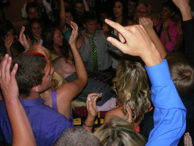 Tylar Zielinski's class dances with him at their senior banquet. (Photo courtesy of Shawn Zielinski)