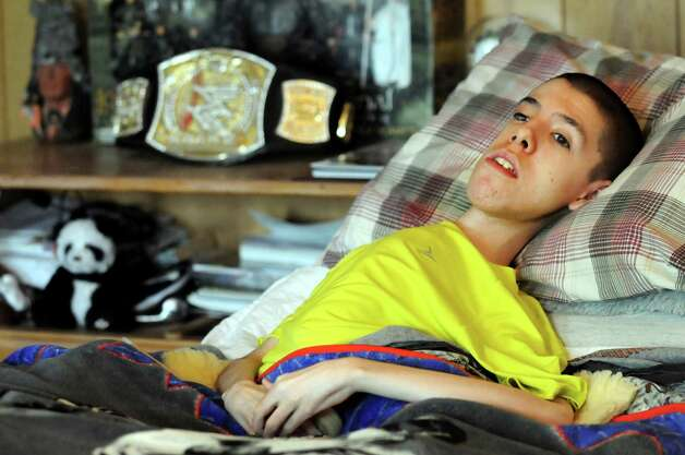 Tylar Zielinski, 20, who has Duchenne muscular dystrophy, on Tuesday, June 19, 2012, at his home in Sprakers, N.Y. Tylar graduated from Fonda-Fultonville High School in June. He died July 6, 2012. (Cindy Schultz / Times Union) Photo: Cindy Schultz / 00018121A