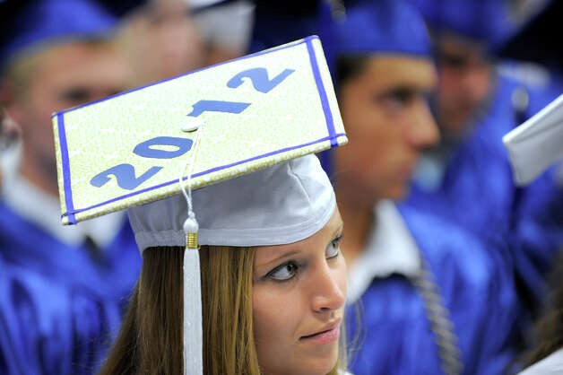 Emily Kopcik, 18, listens to a graduation speaker. Newtown High School held its graduation Wednesday, June 20, 2012 at the O'Neill Center at Western Connecticut State University, in Danbury, Ct. Photo: Carol Kaliff / The News-Times