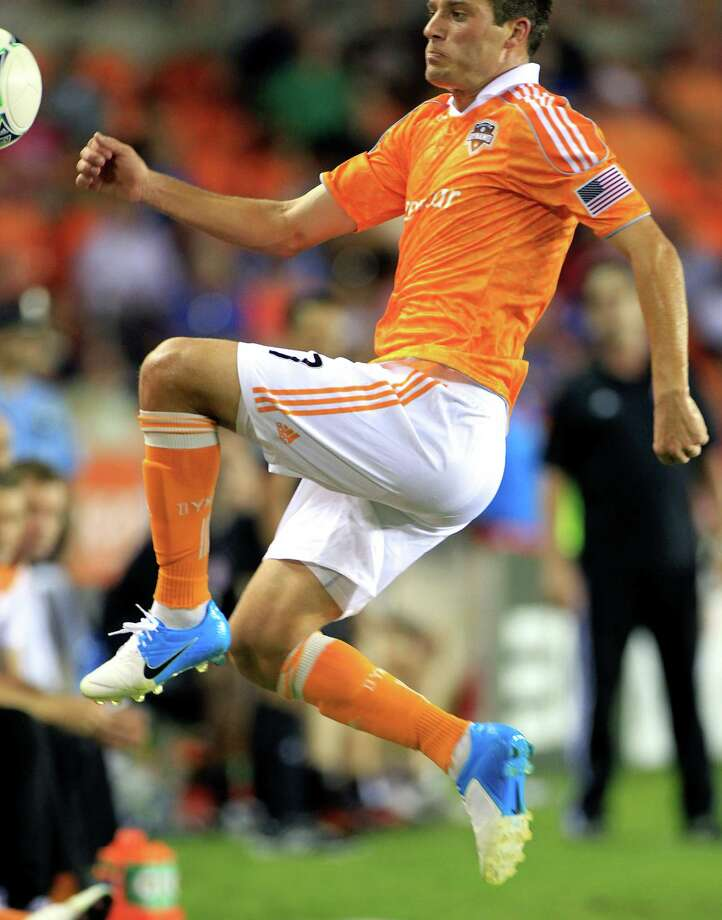 Houston Dynamo's Colin Clark chases a ball out of bounds during the second half of a soccer game against the Toronto FC at BBVA Compass Stadium Wednesday, June 20, 2012, in Houston. The game ended in a 3-3 draw. Photo: Cody Duty, Houston Chronicle / © 2011 Houston Chronicle