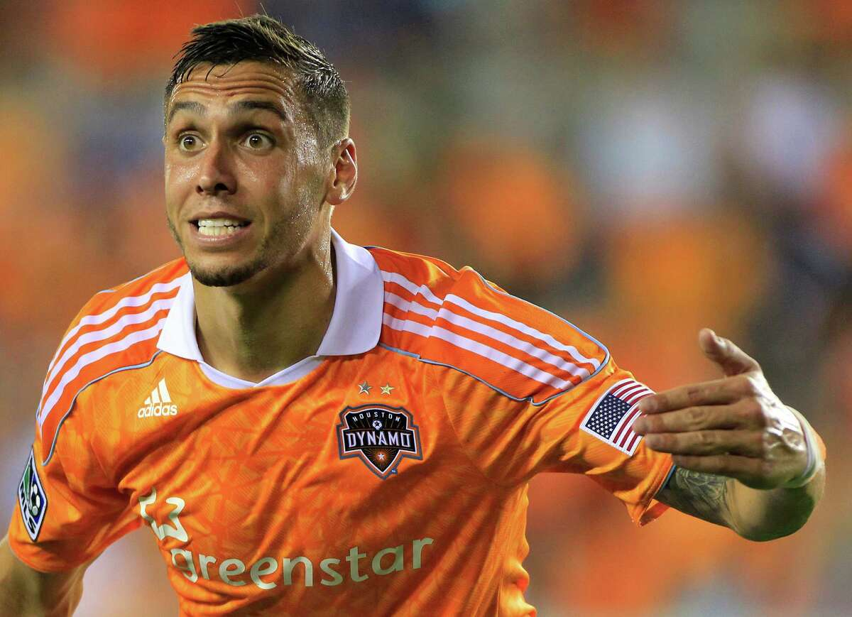 Houston Dynamo's Geoff Cameron argues with officials during the second half of a soccer game against the Toronto FC at BBVA Compass Stadium Wednesday, June 20, 2012, in Houston. The game ended in a 3-3 draw.