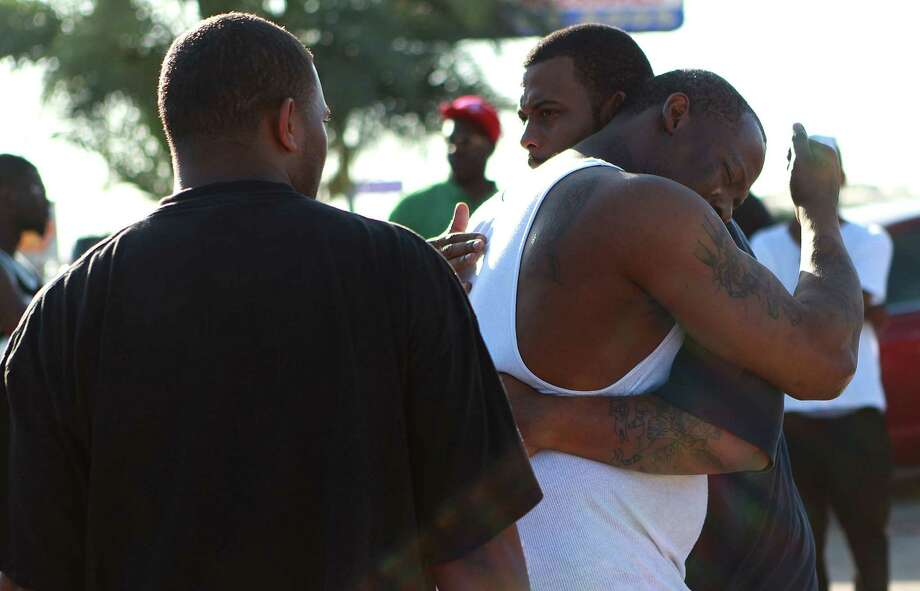 It was an emotional scene Wednesday in the aftermath of a shooting near a local club that left three people dead and two hurt. Photo: Johnny Hanson / © 2012  Houston Chronicle