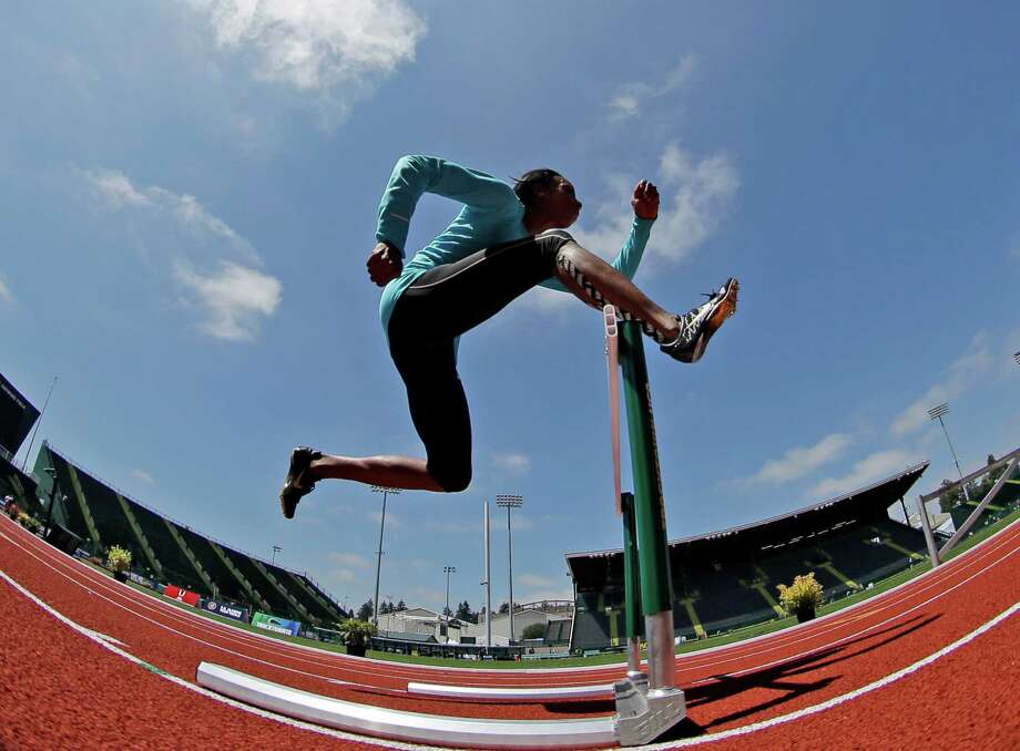 Lashinda Demus, who will compete in the 400-meter hurdles, works out Thursday in Eugene, Ore., where the U.S. track and field trials begin today. Photo: Matt Slocum / AP