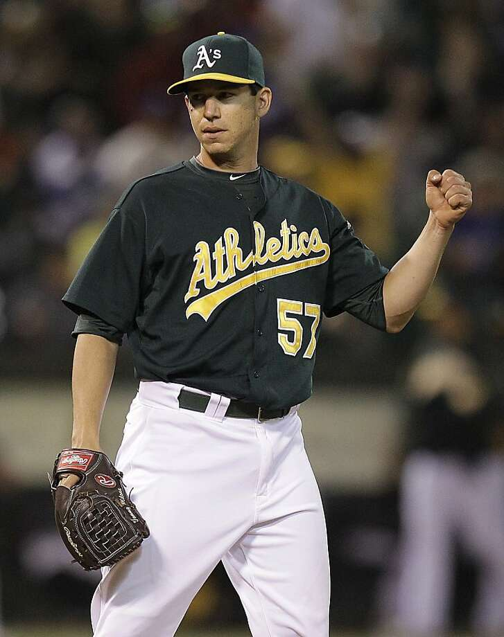 Oakland Athletics' Tommy Milone celebrates at the end of the baseball game against the Los Angeles Dodgers Wednesday, June 20, 2012, in Oakland, Calif. (AP Photo/Ben Margot) Photo: Ben Margot, Associated Press