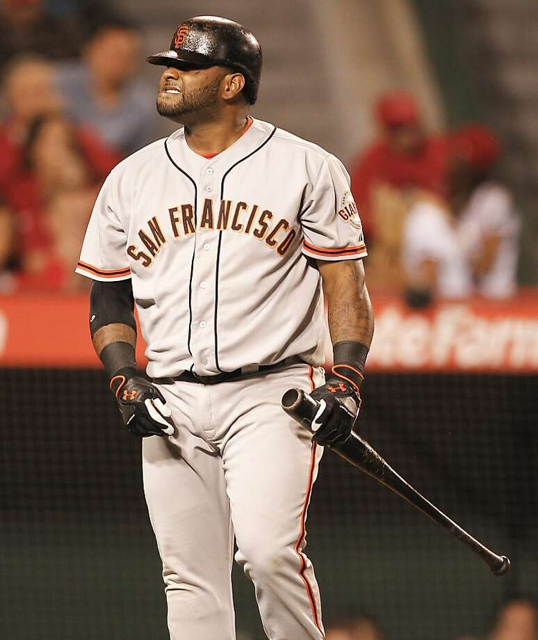 San Francisco Giants' Pablo Sandoval reacts after striking out against the Los Angeles Angels during the seventh inning of a baseball game in Anaheim, Calif., Wednesday, June 20, 2012. (AP Photo/Chris Carlson) Photo: Chris Carlson, Associated Press