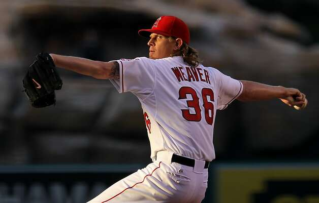 ANAHEIM, CA - JUNE 20:  Jered Weaver #36 of the Los Angeles Angels of Anaheim throws a pitch against the San Francisco Giants in an interleague game at Angel Stadium of Anaheim on June 20, 2012 in Anaheim, California.  (Photo by Stephen Dunn/Getty Images) Photo: Stephen Dunn, Getty Images