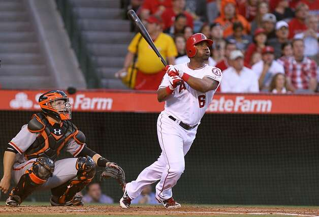 ANAHEIM, CA - JUNE 20:  Alberto Callaspo #6 of the Los Angeles Angels of Anaheim hits a solo home run in the second inning against the San Francisco Giants in an interleague game at Angel Stadium of Anaheim on June 20, 2012 in Anaheim, California.  (Photo by Stephen Dunn/Getty Images) Photo: Stephen Dunn, Getty Images