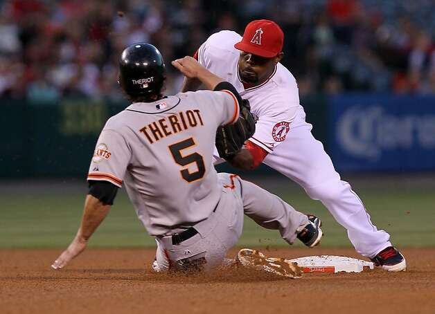 ANAHEIM, CA - JUNE 20:  Second baseman Howie Kendrick #47 of the Los Angeles Angels of Anaheim tags out Ryan Theriot #5 of the San Francisco Giants trying to steal second base in the fourth inning of an interleague game at Angel Stadium of Anaheim on June 20, 2012 in Anaheim, California.  (Photo by Stephen Dunn/Getty Images) Photo: Stephen Dunn, Getty Images