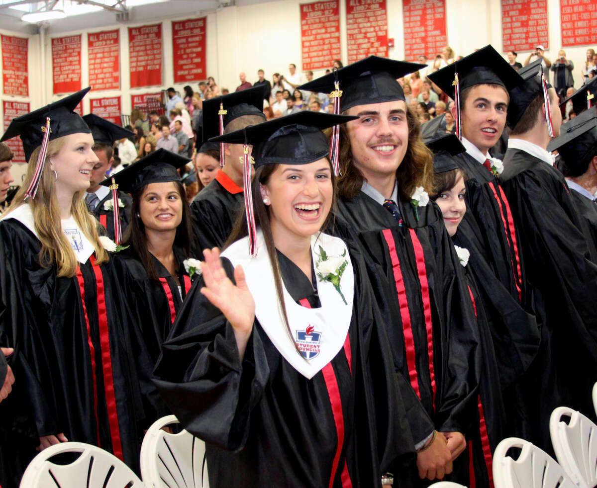 Julia Cipriano waves to the crowd as classmate Peter Cimmino looks on during graduation exercises held at Pomperaug Regional High School on June 20, 2012 in Southbury, CT. Photo taken June 20, 2012.