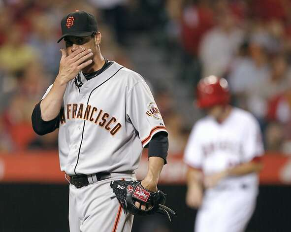 San Francisco Giants starting pitcher Ryan Vogelsong heads to the dugout after the fifth inning of a baseball game against the Los Angeles Angels in Anaheim, Calif., Wednesday, June 20, 2012. Vogelsong gave up two runs in the inning. (AP Photo/Chris Carlson) Photo: Chris Carlson, Associated Press