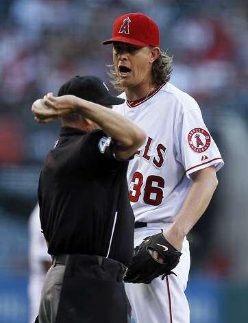Los Angeles Angels starting pitcher Jered Weaver, right, has words with home plate umpire Jerry Meals during the first inning of a baseball game against the San Francisco Giants in Anaheim, Calif., Wednesday, June 20, 2012. (AP Photo/Chris Carlson) Photo: Chris Carlson, Associated Press