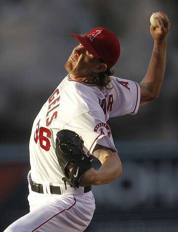 Los Angeles Angels starting pitcher Jered Weaver throws to the San Francisco Giants during the first inning of a baseball game in Anaheim, Calif., Wednesday, June 20, 2012. (AP Photo/Chris Carlson) Photo: Chris Carlson, Associated Press