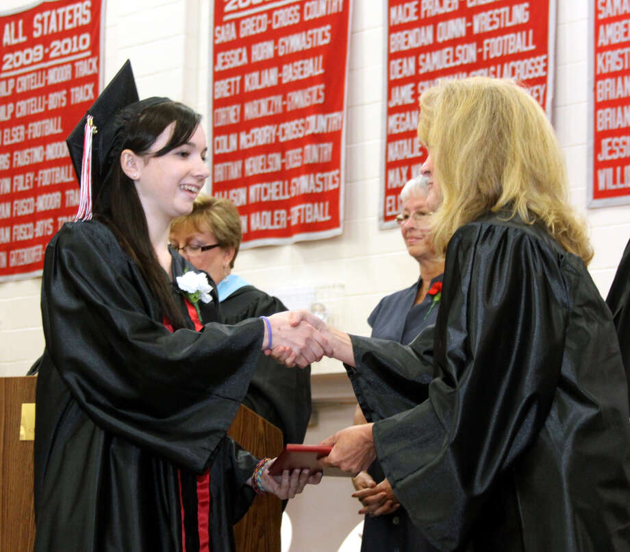 Mackenzie Tucker Ahearn receives her diploma at the graduation exercises held at Pomperaug Regional High School on June 20, 2012 in Southbury, CT. Photo: Walter Kidd