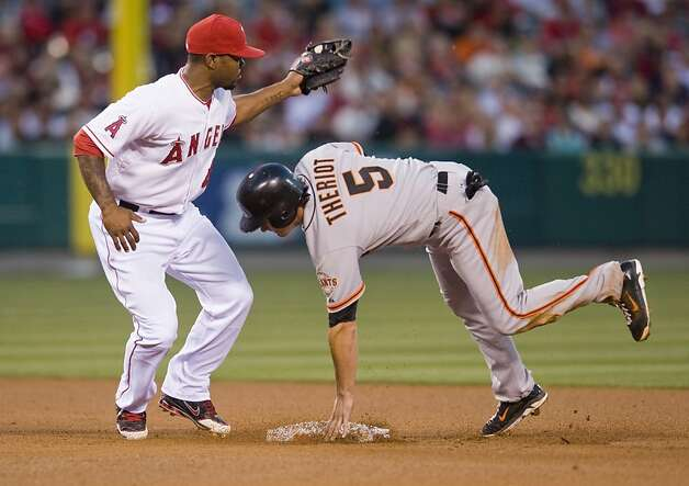San Francisco Giants second baseman Ryan Theriot (5) is caught stealing by Los Angeles Angels second baseman Howard Kendrick (47) in the 3rd inning Wednesday, June 20, 2012, at Angel Stadium in Anaheim, California. (Michael Goulding/Orange County Register/MCT) Photo: Michael Goulding,, McClatchy-Tribune News Service