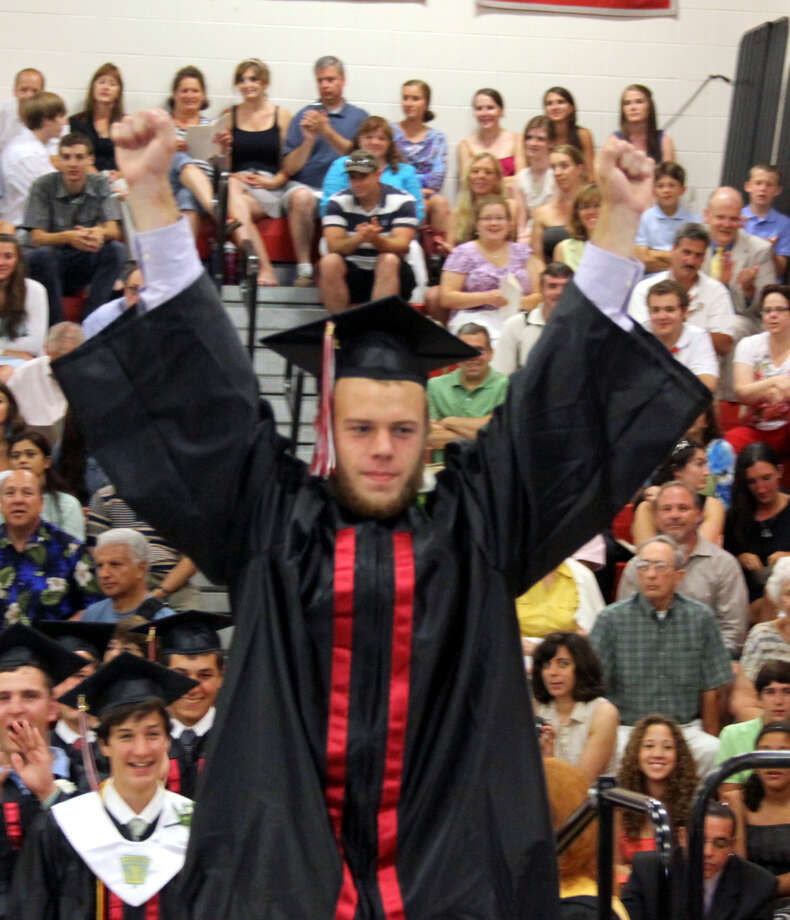 Michael Christopher Burke receives his diploma at the graduation exercises held at Pomperaug Regional High School on June 20, 2012 in Southbury, CT. Photo: Walter Kidd