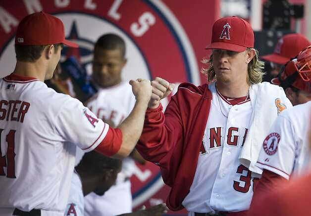 Los Angeles Angels starting pitcher Jered Weaver (36) greets teammates before the start of the Angels' game against the  San Francisco Giants Wednesday, June 20, 2012, at Angel Stadium in Anaheim, California. (Michael Goulding/Orange County Register/MCT) Photo: Michael Goulding,, McClatchy-Tribune News Service
